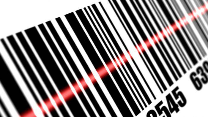 Scanner scanning barcode on with white background. Depth of fields.