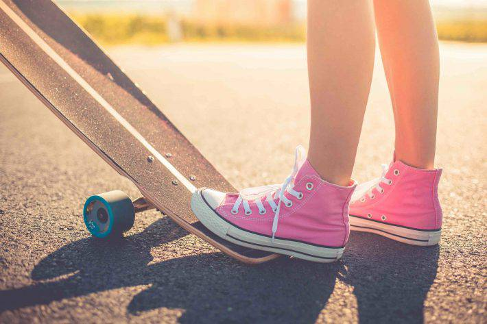 happy-girl-with-pink-shoes-ready-to-longboard-ride-picjumbo-com