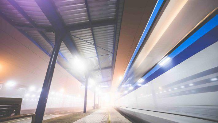 train-leaving-the-railway-station-at-night-picjumbo-com