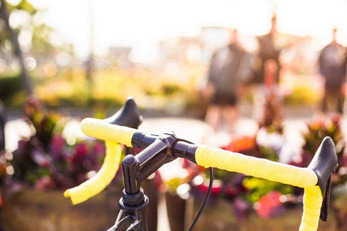 yellow-bicycle-handlebars-close-up-picjumbo-com